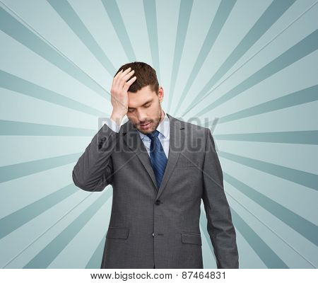 business, fail and crisis concept - young businessman having headache over blue burst rays background
