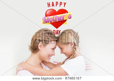 mothers heart against mother and daughter smiling at each other