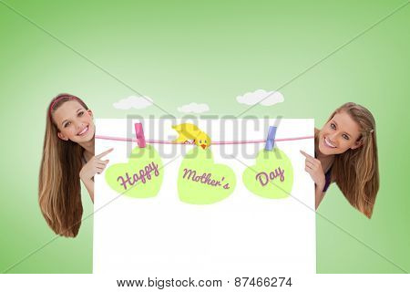 Portrait of wo long hair women back of a blank sign against green vignette