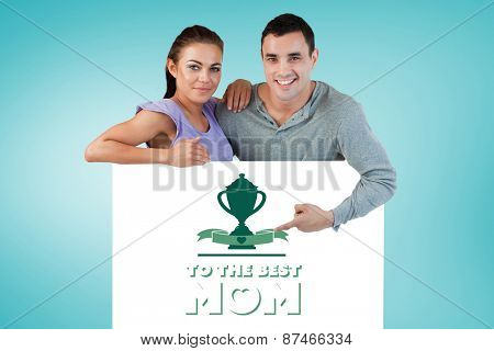 Young couple presenting advertisement against blue vignette background