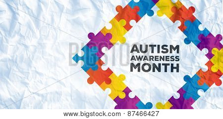 Autism awareness month against crumpled white page