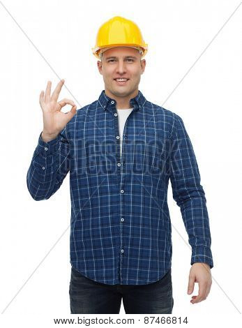 repair, construction, building, people and maintenance concept - smiling male builder or manual worker in helmet showing ok sign