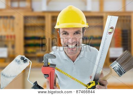 Happy worker with various equipment against workshop