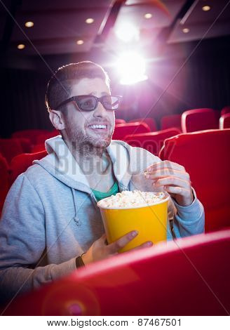 Young man watching a 3d film at the cinema