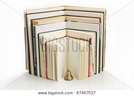Books In Expanded Form With A Bell.