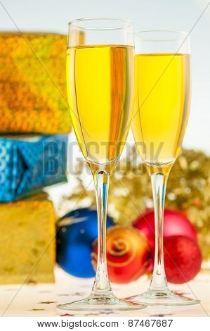 Two Glasses With Champagne And Christmas Gifts