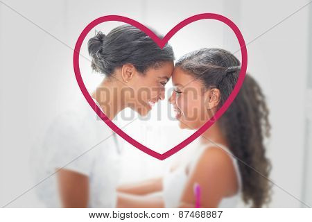 Heart against pretty mother hugging her daughter