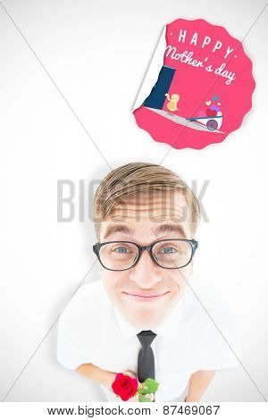 Geeky hipster holding a red rose against chick with wheelbarrow of hearts