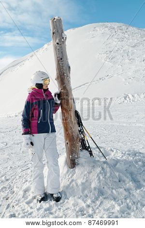 Young female skier admiring the stunning view