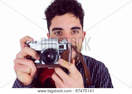 Casual man taking a photo shot in studio