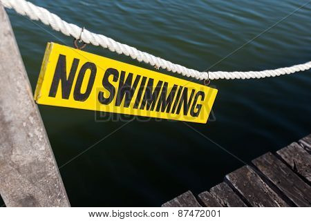 No Swimming Sign On Wooden Tablet