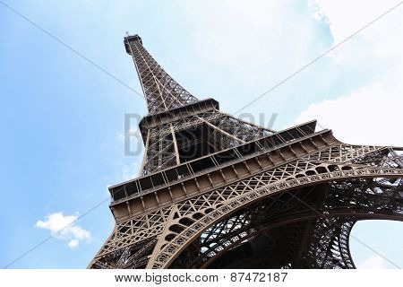 Eiffel Tower In Paris, France On A Blue Sky