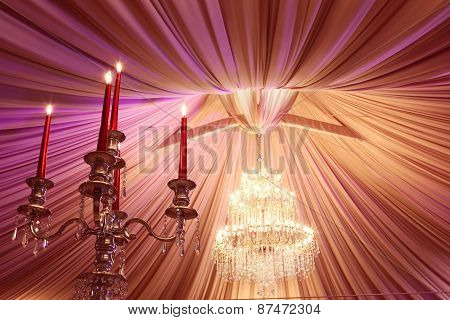 Ancient Candle Sticks And A Chandelier On A Wedding Day