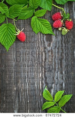 Old Wooden Board Decorated Raspberry And Leaves