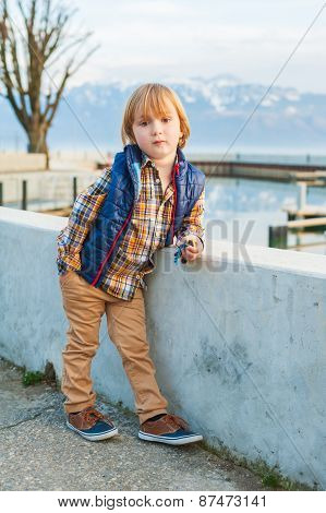 Outdoor portrait of a cute fashion little boy of 4 years old