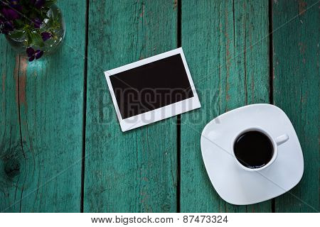 Empty Photo Card On Old Wooden Table
