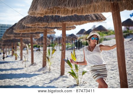 Tanned Woman On Vacation Under Thatched Hut