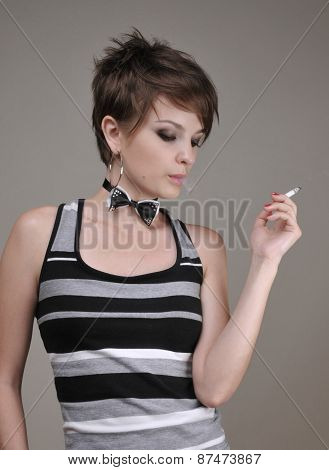 Portrait of beautiful girl with cigarette