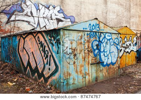 Old Rusted Locked Garages With Grungy Graffiti