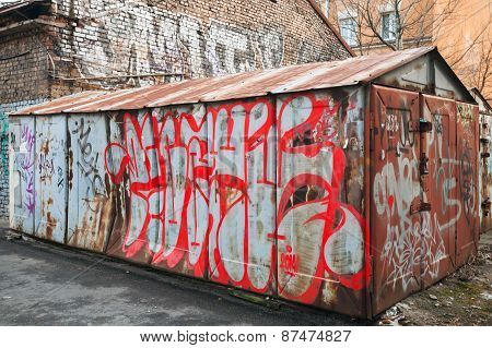 Old Abandoned Garage With Chaotic Grungy Graffiti