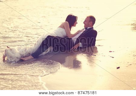 groom and bride on the shore