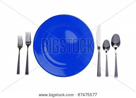 Blue Plate, Forks, Knife And Spoons Isolated On White
