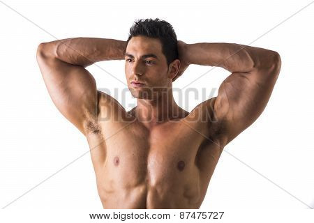 Muscular Man Looking Afar While Holding his Head Showing Bulging Biceps