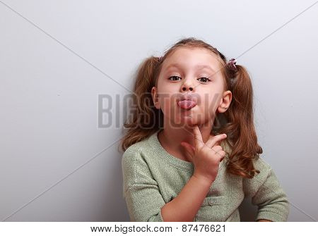 Thinking Grimacing Girl Showing Tongue With Finger Under Face