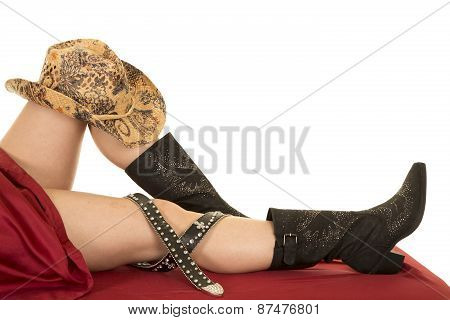 Woman Legs Under Sheet With Cowboy Boots Hat And Belt Around Knee