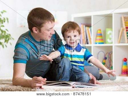 Happy Father Read A Book To Child