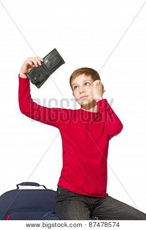 Portrait Of A Boy Sitting On Travel Bags Looking Insight Empty Wallet