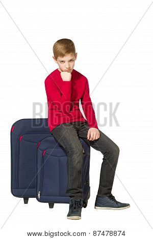 Sad Boy Sitting On Travel Bags Isolated On White
