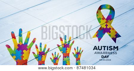 Autism awareness day against bleached wooden planks background
