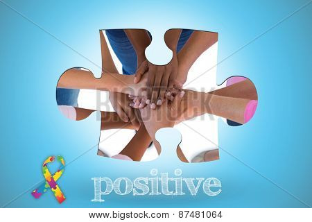 The word positive and group wearing pink and ribbons for breast cancer with hands together against blue background with vignette
