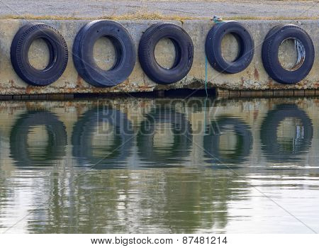 Tires Protecting The Boats In The Harbor