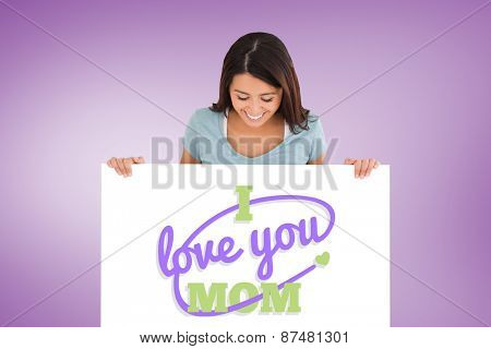 Good looking woman holding a board against purple vignette