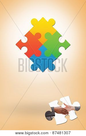 Businessman going shaking a hand against orange vignette