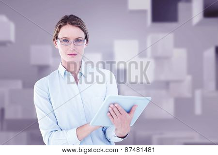 Businesswoman using tablet pc against abstract white room