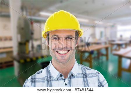 Architect wearing hardhat over white background against workshop