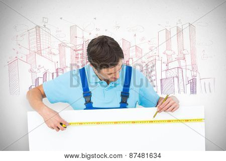 Carpenter measuring blank bill board against grey
