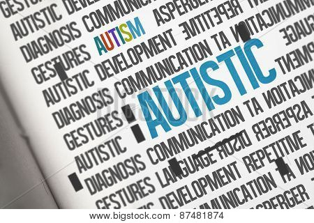 The word autistic against open book