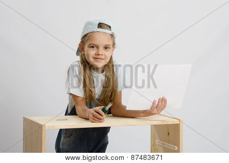 Girl-collector Of Furniture With A Screwdriver And Drawing Collects Furniture