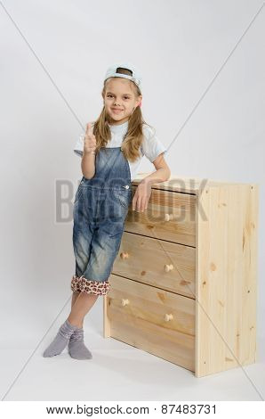 Girl In Overalls Collector Of Furniture Based On The Chest Shows Class