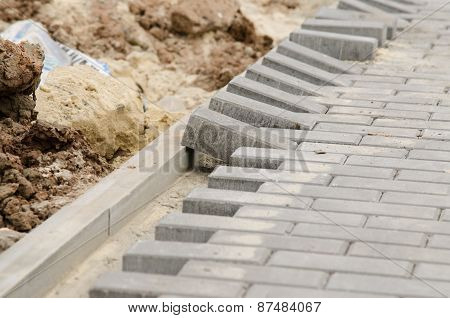 Laying Of Paving Slabs To Curb