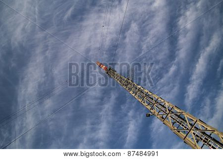 Red And White Radio Tower In Unusual Angle