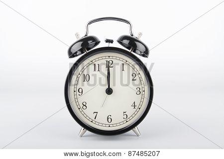 Twelve O'clock. Alarm Clock.
