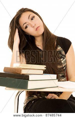 Girl At School Desk Running Her Fingers Through Her Hair