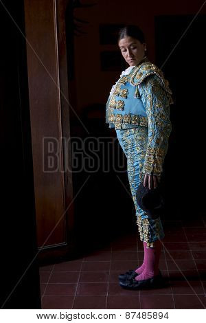 Woman Bullfighter In Hotel Room Before Going To The Plaza De Toros In Seville, Spain, On A Black Bac