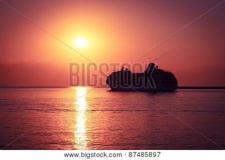 Cruise Ship at Sunset. Majestic Background.