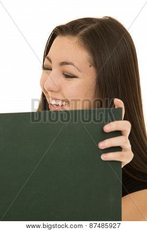 Cute Aisan American Female Student Reading A Text Book